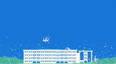 風見沢高校を背景にツバメが弧を描く